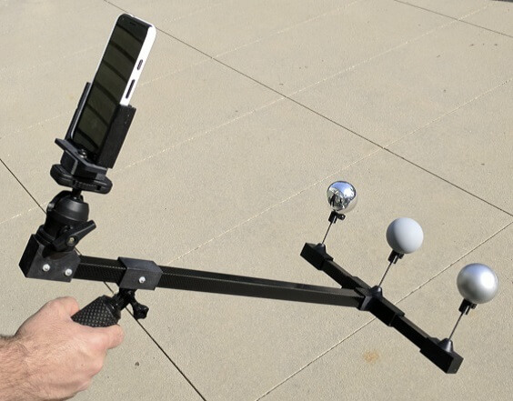 Capturing setup based on a smartphone and three spheres with varied materials to capture different light properties.