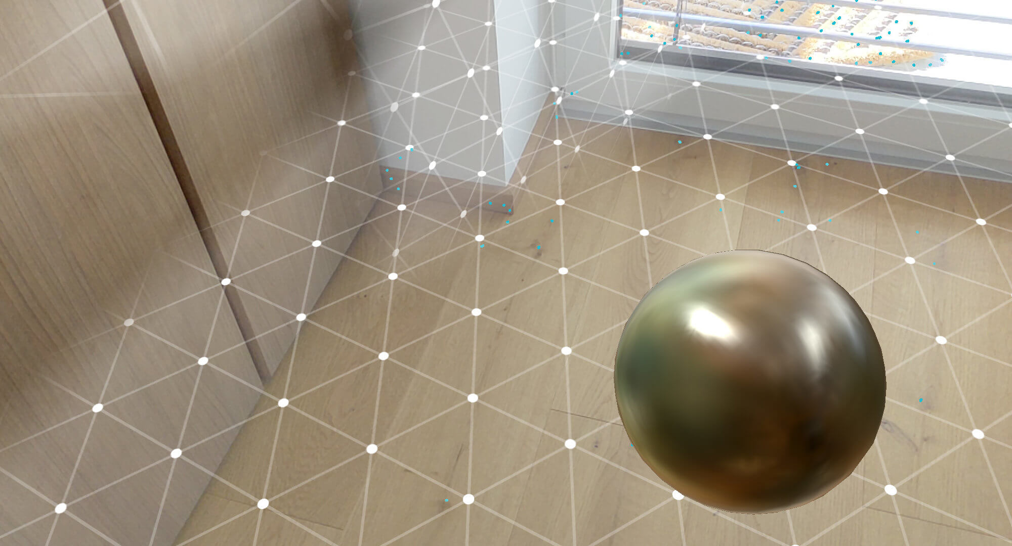 Screenshot of the reflective sphere placed in the real world, based on the Environmental HDR lighting by Google ARCore.